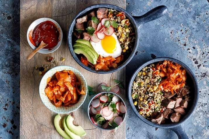 Carne Asada Bibimbap with Fiesta Rice Gochujang Salsa and Fried Egg Recipe Image